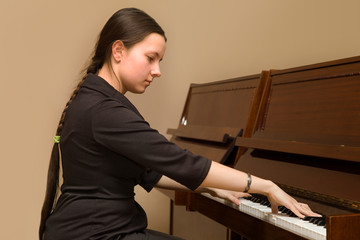 The girl playing the piano