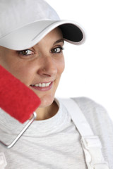 female house painter with red roller and cap
