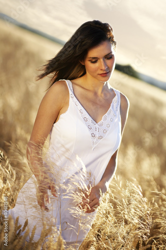 Beautiful Woman relaxing in the Field
