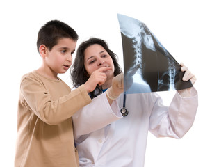 Pediatrician shows her child patient neck x-ray isolated