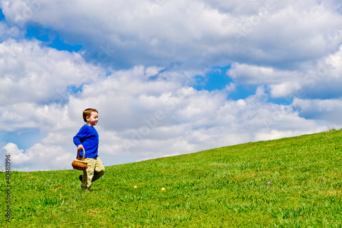 Young boy running with basket to collect Easter Eggs