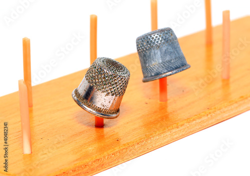 old thimble on white background