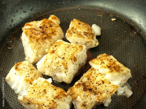 Frying seasoned white fish in a frying pan from arve for How to season fish for frying