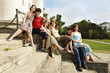 Group of Teenagers sitting on the stair, smiling
