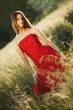 Girl in red clothes on the meadow