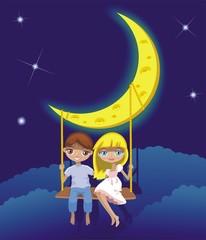 Мальчик и девочка на качелях