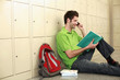 Man talking on the phone while reading