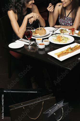 Women having a meal after shopping