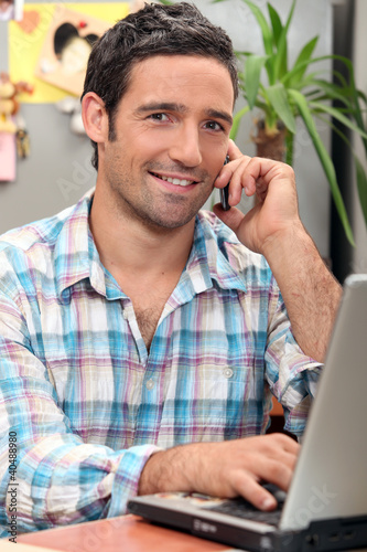 Man with computer at home