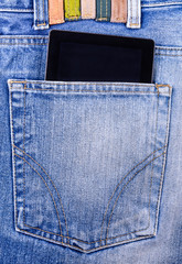 The tablet in his pocket jeans