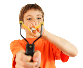 Boy wearing in orange t-shirt with slingshot aim to camera