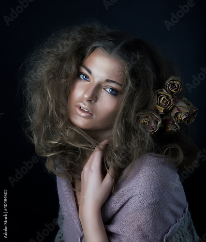 Beauty. Sexy young sensual woman with beautiful long curly hair