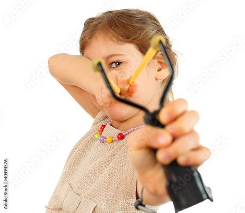 Girl with slingshot aim to camera isolated on white background
