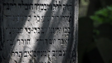 Close-up of Jewish tomb in changing sunlight