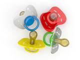 Baby's pacifiers on white isolated background.
