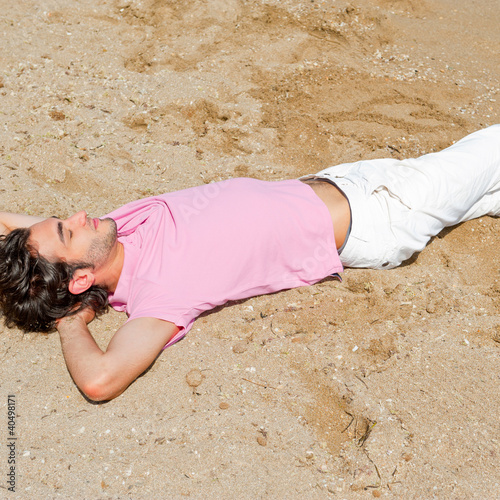 Portrait of attractive and happy man on the beach relaxing