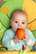 Child biting orange