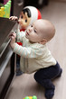 Kid mounting on cupboard