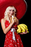 Young woman holding bananas