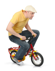 Cool guy goes on a children's bicycle on white