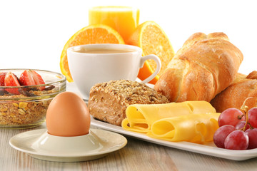 Breakfast with coffee, rolls, egg, orange juice, muesli and chee