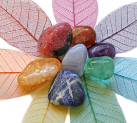 Chakra stones on skeleton leaves, close up