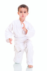 Aikido boy fighting position in white kimono