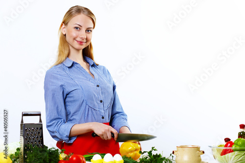 Woman cooking fresh meal at home
