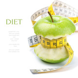 Fototapety Green apple core and measuring tape. Diet concept