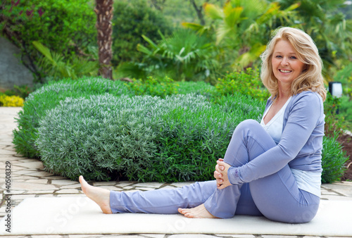 mature woman relaxing  in yoga position