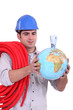 Plumber, a globe and banknotes