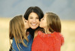 Girls kissing mother