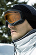 Close up of a man wearing ski goggles