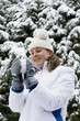 Woman having fun playing snowball