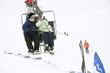 Couple enjoying the view from chair lift