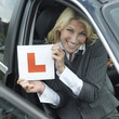 Businessman smiling while holding L plate