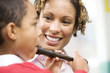 Woman teaching boy to play recorder