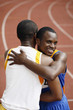Men hugging each other after the race