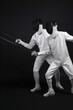 Two men with fencing foils