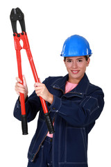 Woman builder holding nippers