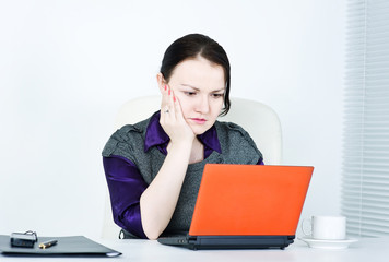 Worried business woman using laptop