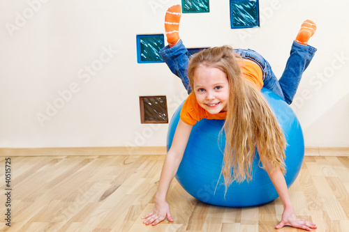 Girl playing with gymnastic ball