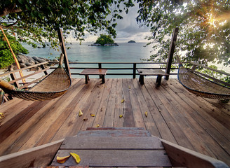 Seculed terrace with wooden hammocks