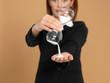 attractive, young businesswoman holding broken hourglass