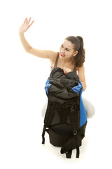 young female tourist with backpack, wave hello, full length
