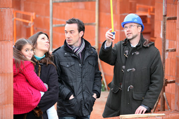 Family visiting construction site