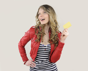 young woman with credit or gift card
