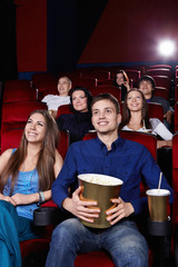 Smiling people in the cinema