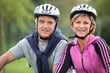 Senior couple on a bicycle with helmet