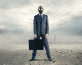 doomsday: portrait of businessman in a gas mask  with suitcase